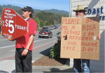 Richard Salzman: Please buy me a pizza before I am arrested for holding this sign.